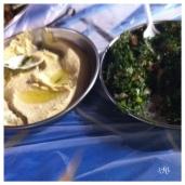 "Hummus: a dip consisting of mashed chickpeas (garbanzo beans), tahini, garlic, and lemon. Tabbouleh: a ""salad"" generally made of parsley, bulgur, tomatoes, garlic, and lemon"